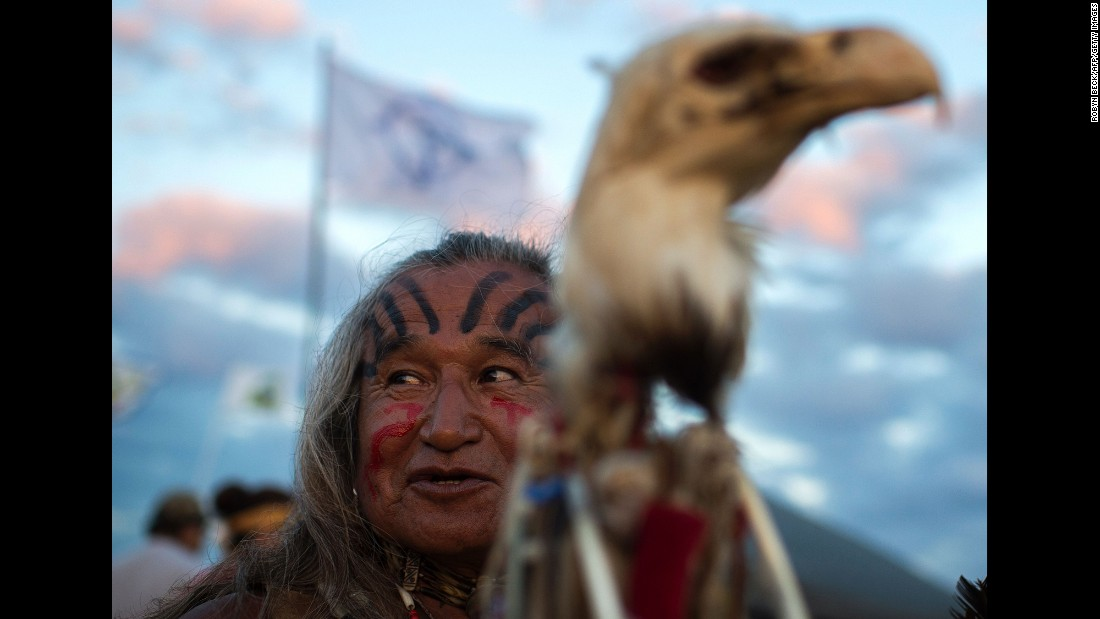 Phil Little Thunder Sr. attends an evening gathering at an encampment of Dakota Access Pipeline protesters on September 3.