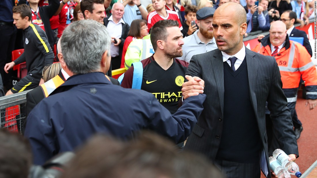 Manchester United manager Jose Mourinho shakes hands with  Manchester City manager Pep Guardiola prior to the Premier League match between Manchester United and Manchester City at Old Trafford on September 10, 2016 in Manchester, England.