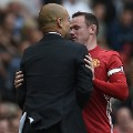 Wayne Rooney and Manchester City's Spanish manager Pep Guardiola clash 2