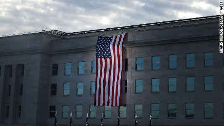 An American flag is draped over the Pentagon where it was hit by an airliner 15 years ago, September 11, 2016 in Arlington, Virginia.