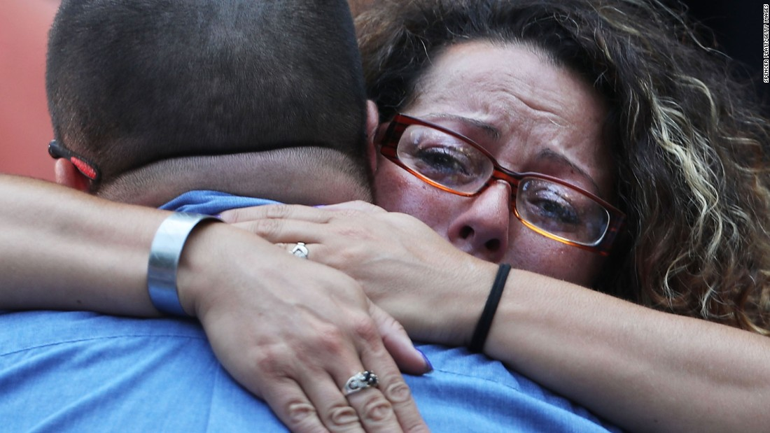 A woman hugs a man during a commemoration ceremony for the victims of the September 11 terrorist attacks in New York.
