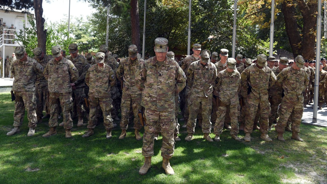 US military personnel attend a memorial ceremony on the 15th anniversary of the September 11, 2001 attacks at the International Security Assistance Force headquarters in Kabul, Afghanistan.