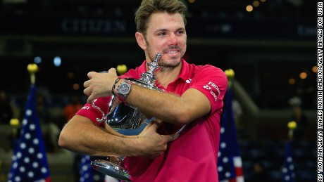 Wawrinka celebrates with the the US Open trophy after beating Djokovic.