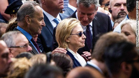 New York City Mayor Bill de Blasio speaks to US Democratic presidential nominee Hillary Clinton during a memorial service at the National 9/11 Memorial September 11, 2016 in New York. The United States on Sunday commemorated the 15th anniversary of the 9/11 attacks.