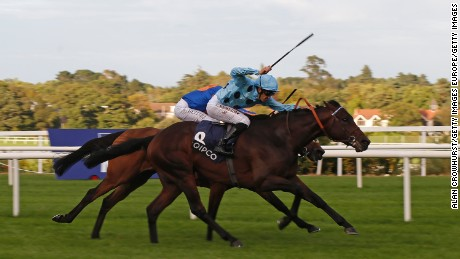 DUBLIN, IRELAND - SEPTEMBER 10:  Christophe Soumillon riding Almanzor (R, light blue) win The Qipco Irish Champion Stakes at Leopardstown racecourse on September 10, 2016 in Dublin, Ireland. (Photo by Alan Crowhurst/Getty Images)