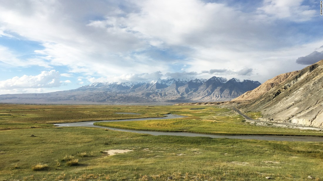 Stunning grasslands appear along the Karakoram Highway, with the Tian Shan range behind.