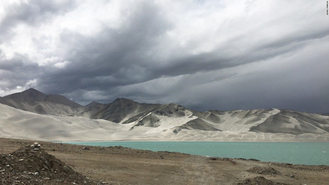 Otherworldly sand dunes behind Karakul Lake.