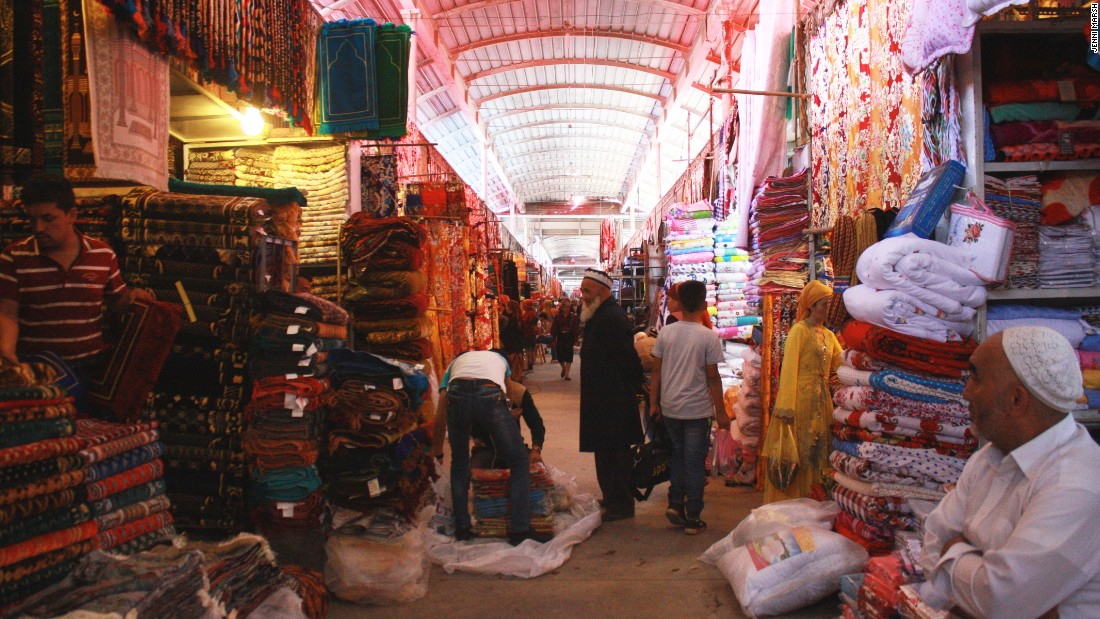 Rugs, spices, trinkets and food are all on sale at the bazaar in Kashgar.