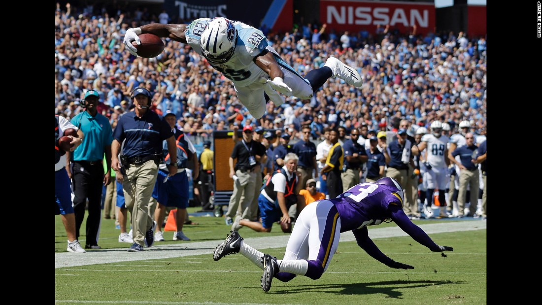 Tennessee's DeMarco Murray dives for a touchdown over Minnesota's Terence Newman during an NFL game in Nashville on Sunday, September 11. Minnesota won 25-16.