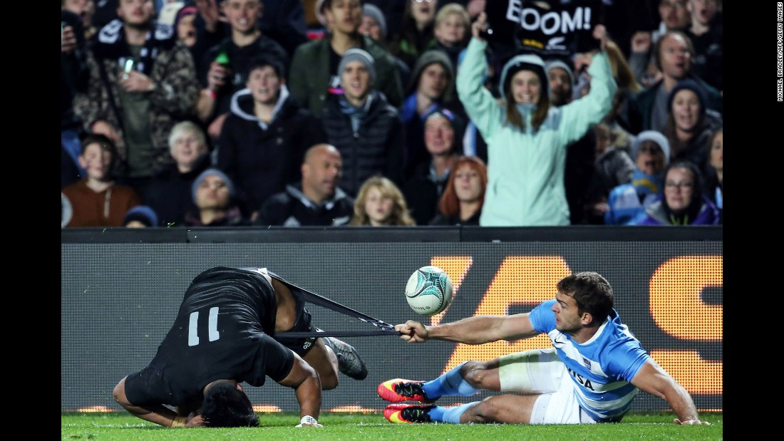 Julian Savea of New Zealand is tackled by Argentina's Ramiro Moyano during the Rugby Championship match in Hamilton, New Zealand, on Saturday, September 10. New Zealand dominated the second half, winning 57-22.
