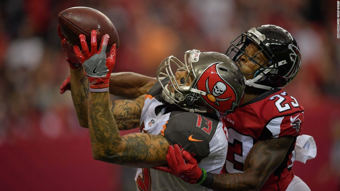 Mike Evans of Tampa Bay catches a touchdown pass in front of Atlanta's Robert Alford during the second half in Atlanta on Sunday, September 11. Tampa Bay won 31-24.