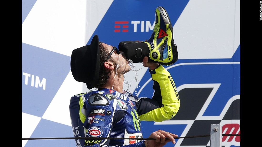Motorcycle racer Valentino Rossi drinks from his boot after finishing second in the San Marino Grand Prix in Misano Adriatico, Italy, on Sunday, September 11.