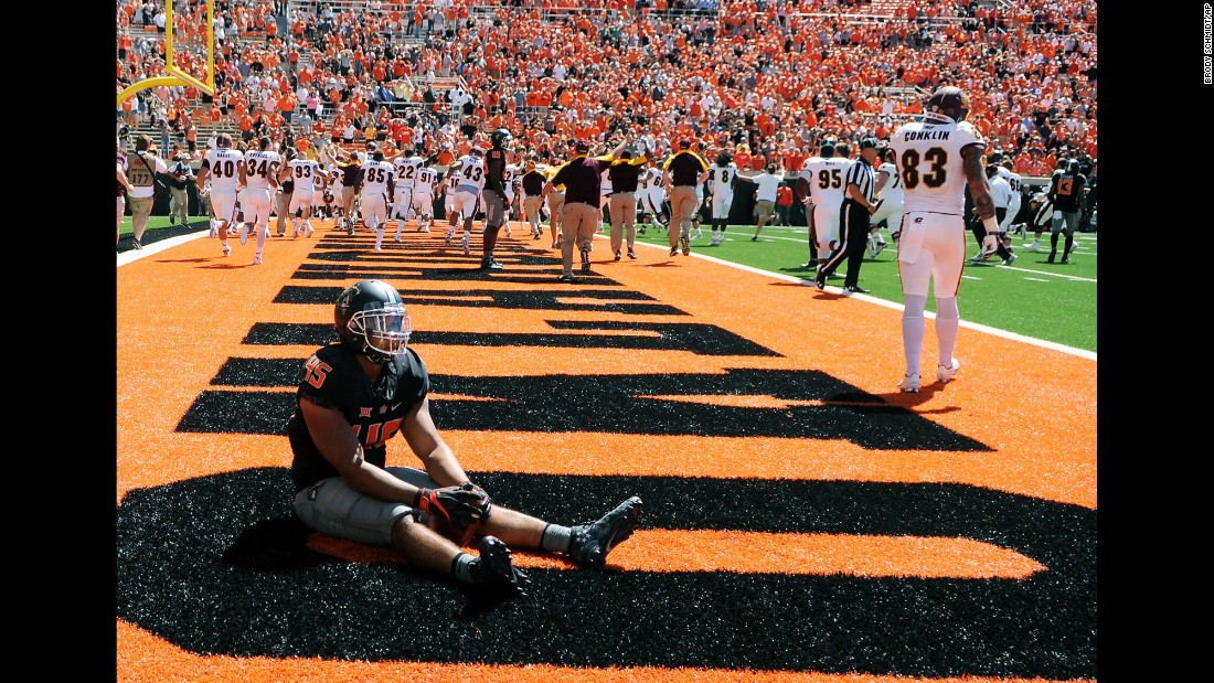 Oklahoma State's Chad Whitener sits in the Central Michigan end zone after a touchdown by Central Michigan's Corey Willis during a game in Stillwater, Oklahoma, on Saturday, September 10. Central Michigan stunned Oklahoma State with a last-play touchdown winning the game 30-27.