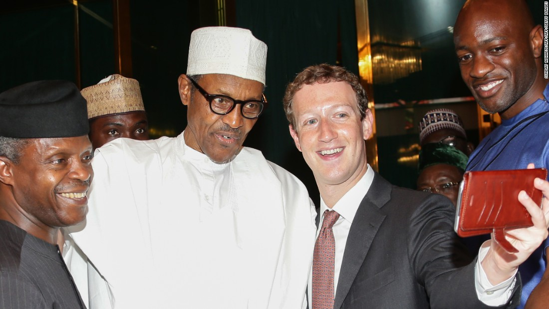 Pictured: Nigerian President Muhammadu Buhari (C) and Vice President Yemi Osinbajo (L) pose as Facebook founder Mark Zuckerberg (2nd R) takes a selfie picture with them, during a visit to the presidential palace in Abuja, Nigeria, on September 2, 2016.