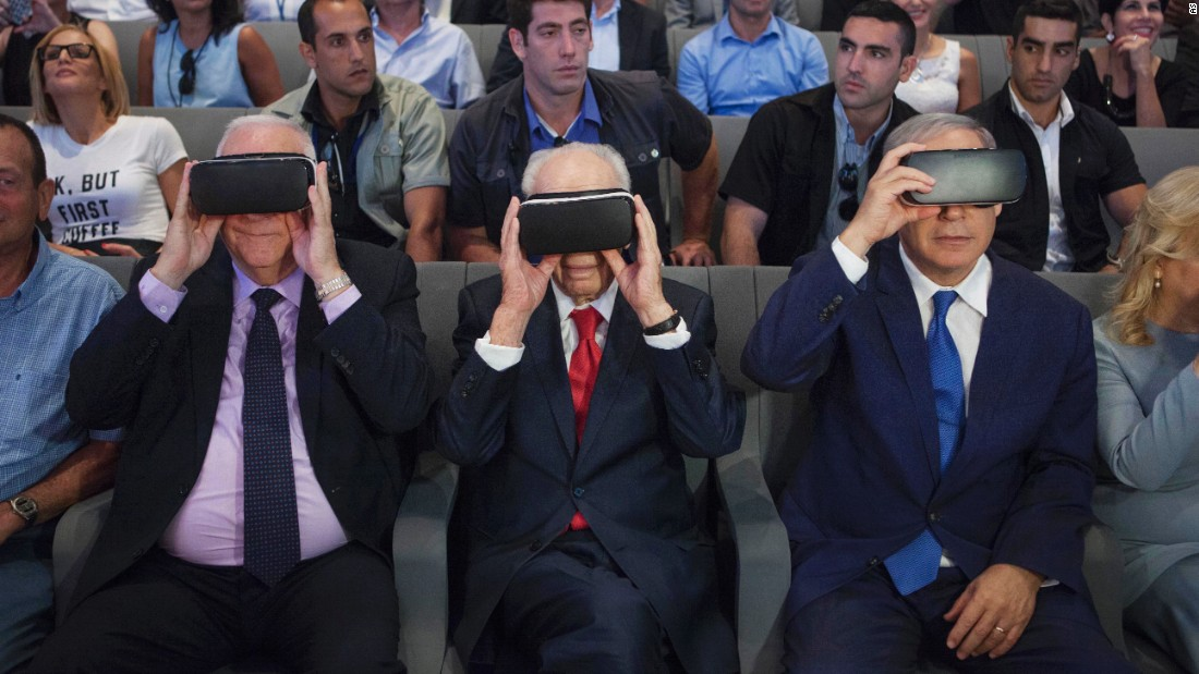 Israeli President Reuven Rivlin, left, former Israeli President Shimon Peres, center, and Israeli Prime Minister Benjamin Netanyahu wear virtual-reality goggles during a presentation at the Peres Center for Peace in Jaffa on July 21, 2016.