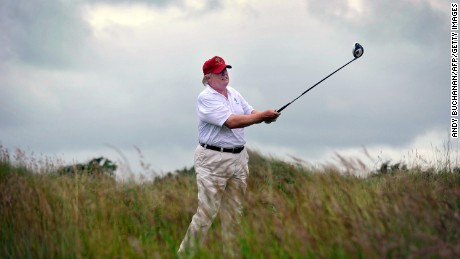 US tycoon Donald Trump plays a stroke as he officially opens his new multi-million pound Trump International Golf Links course in Aberdeenshire, Scotland, on July 10, 2012. Work on the course began in July 2010, four years after the plans were originally submitted.  AFP PHOTO / Andy Buchanan        (Photo credit should read Andy Buchanan/AFP/Getty Images)