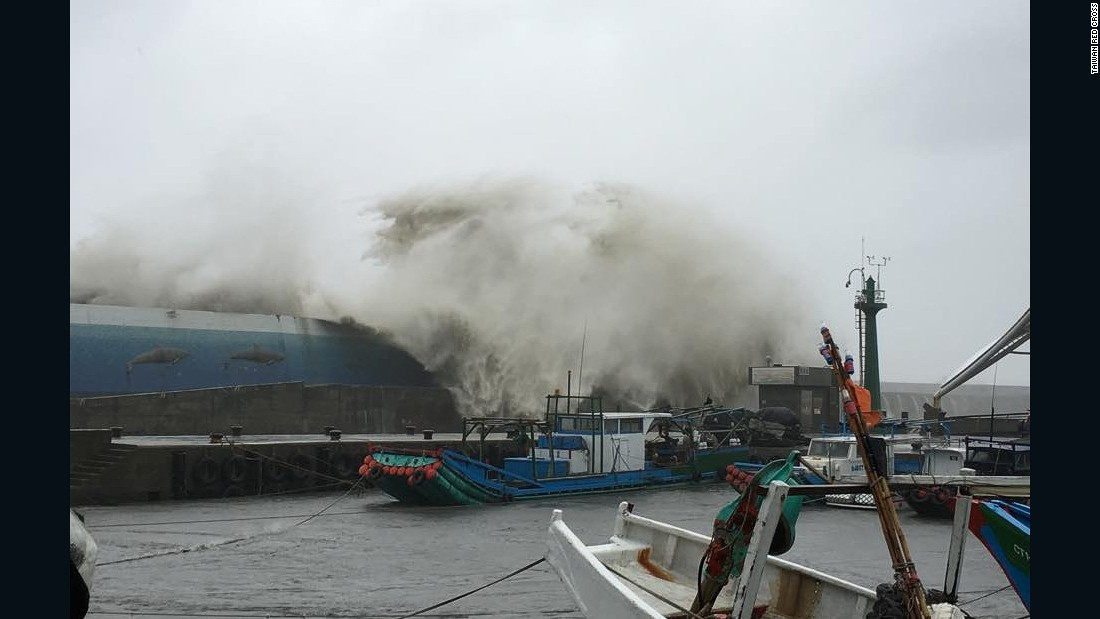 Huge waves wash over a ship in a fishing port in Taitung county, Taiwan.
