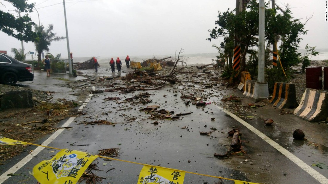 Recovery workers survey storm damage near Fugang in southern Taiwan.