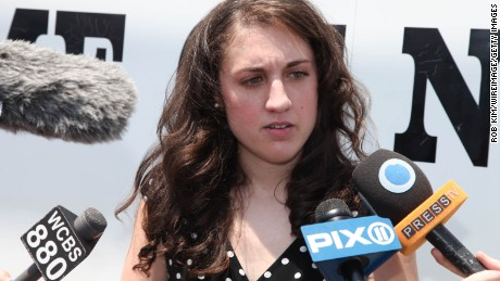 Activist Cecily McMillan speaks with reporters after her release from the Rikers Island jail in July 2014.