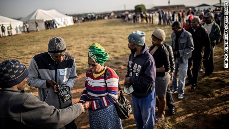 South African voters having their ID checked digitally at a polling station