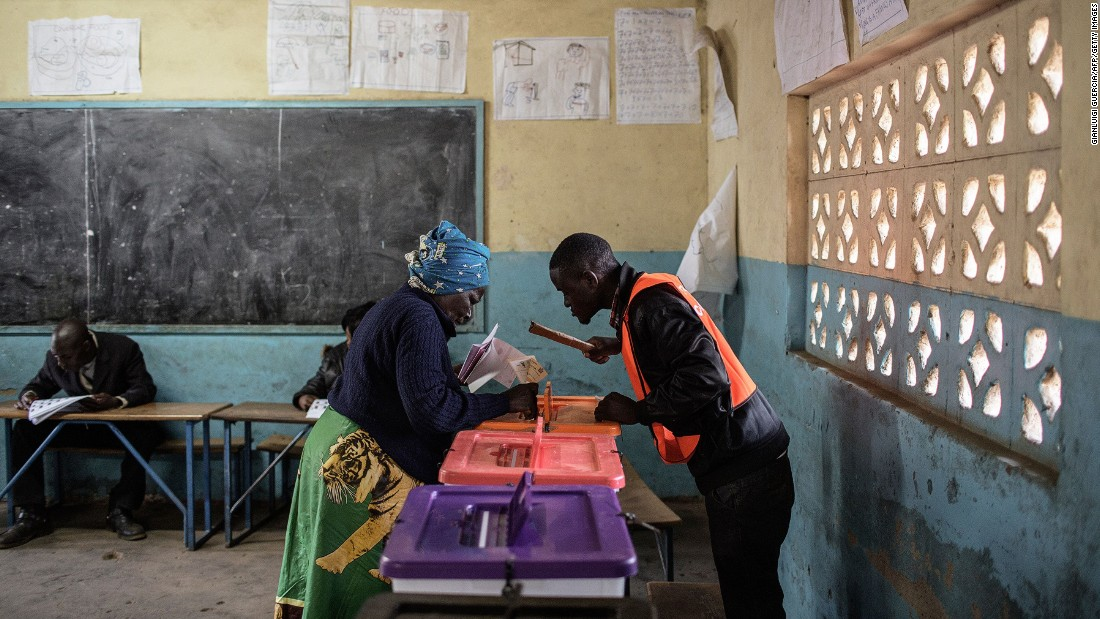 Zambians also went to the polls in August for their general elections. Pictured here, a Zambian woman casts her ballot at a polling station in a school.