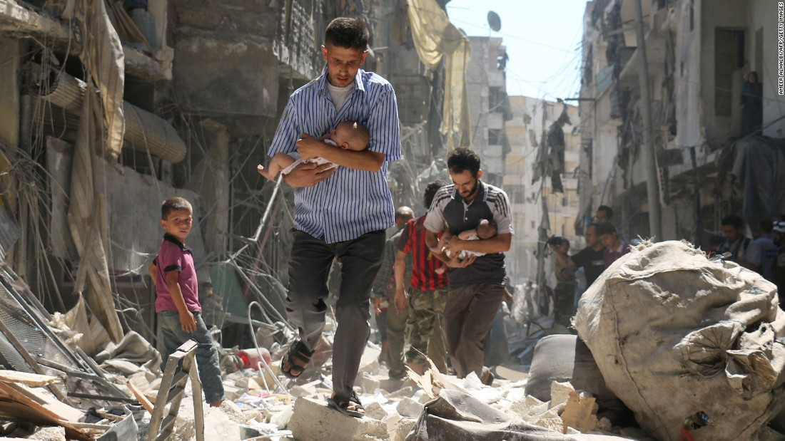 "People walk through the rubble following a reported airstrike in rebel-held Aleppo, Syria, on Sunday, September 11. The next day, the US and Russia <a href=""http://www.cnn.com/2016/09/12/middleeast/syria-ceasefire-explained/"" target=""_blank"">negotiated a ceasefire</a> aimed at ending the five-year Syrian civil war. As of Thursday, <a href=""http://www.cnn.com/2016/09/15/middleeast/syria-ceasefire/index.html"" target=""_blank"">at least 23 people were killed</a> during airstrikes in the country, and both the US and Russia have accused each other of violating their ceasefire obligations."