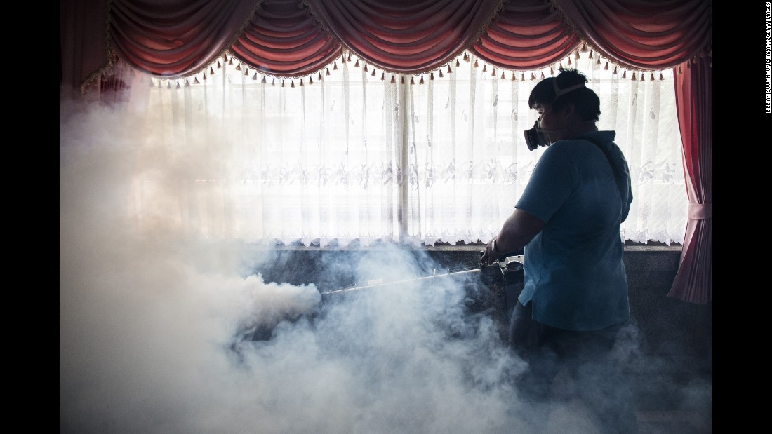 A worker sprays chemicals to kill mosquitoes in an effort to control the spread of the Zika virus at a school in Bangkok, Thailand, on Wednesday, September 14.