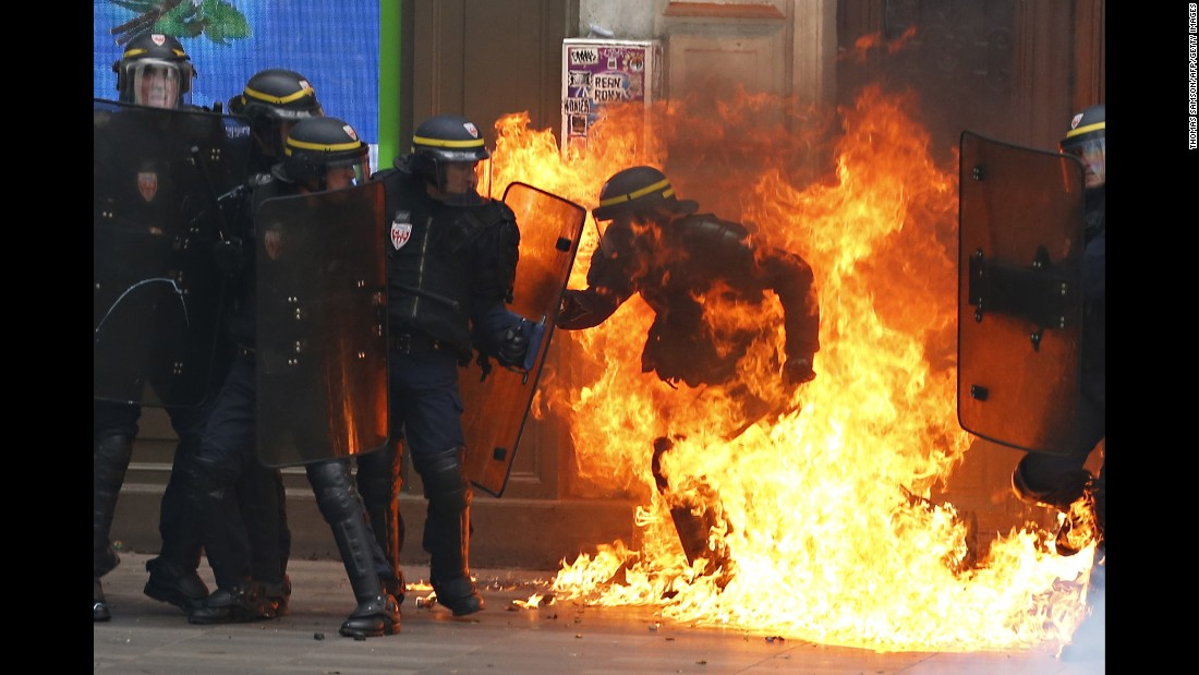 "A riot police officer is surrounded by flames during a demonstration against new labor law reforms in Paris on Thursday, September 15. <a href=""http://www.cnn.com/2016/06/02/europe/france-strikes-labor-reform-bill/index.html"" target=""_blank"">Demonstrations against the reforms</a> -- which include changes in the number of hours staff are expected to work and easier means for companies to hire and fire people -- have been taking place for about six months throughout France."