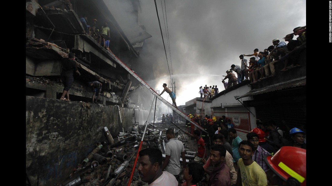 "Firefighters attempt to extinguish a fire at a garment packaging factory in Tongi, Bangladesh, on Saturday, September 10. At least 23 people were killed after an explosion in the boiler room of the factory, <a href=""http://www.bbc.com/news/world-asia-37327033"" target=""_blank"">according to the BBC</a>."