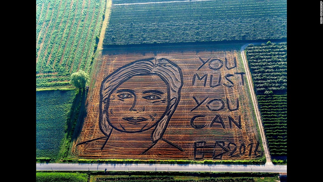 A giant portrait of US Democratic presidential nominee Hillary Clinton is plowed on a field in Castagneto, Italy, on Tuesday, September 13.
