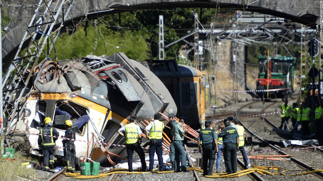 "Spanish police officers, firefighters and security members inspect the wreckage of a <a href=""http://www.cnn.com/2016/09/09/europe/spain-train-crash-vigo/"" target=""_blank"">train that derailed</a> in O Porrino, Spain, on Friday, September 9. At least four people were killed and nearly 50 were injured."