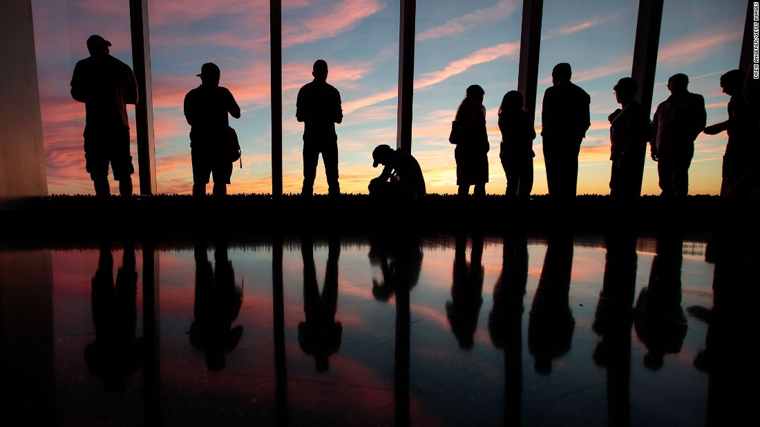 "People watch the sunset from the One World Observatory in New York on Sunday, September 11. <a href=""http://www.cnn.com/2016/09/08/world/gallery/week-in-photos-0909/index.html"" target=""_blank"">See last week in 34 photos </a>"