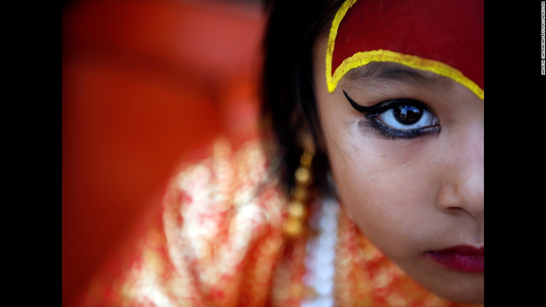 "A child dressed as the goddess Kumari takes part in the Kumari Puja festival in Kathmandu, Nepal, on Wednesday, September 14. Kumari means ""virgin"" and is a Hindu tradition where young pre-pubescent girls are worshipped."