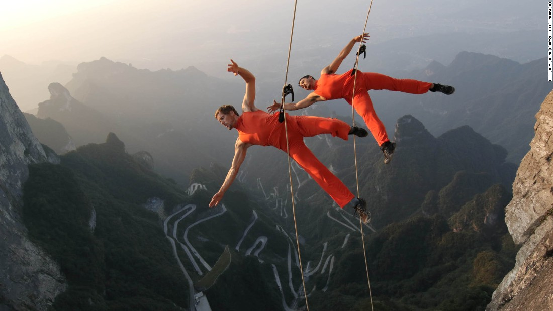A dance group performs on cliffs in Zhangjiajie, China, on Sunday, September 11.