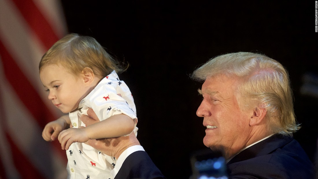 Donald Trump holds Tristan Murphy, 1, following a campaign event in Aston, Pennsylvania, on Tuesday, September 13.