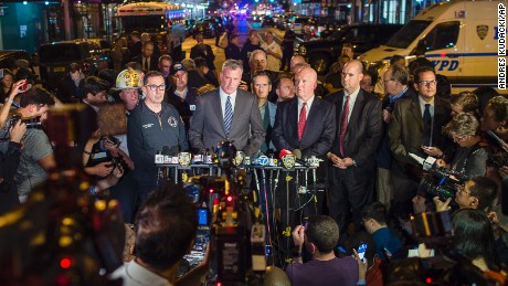 Mayor Bill de Blasio, center, and New York Police Commissioner James O'Neill, center right, speak during a press conference near the scene of an explosion on West 23rd street in Manhattan's Chelsea neighborhood, in New York, Saturday, Sept. 17, 2016.