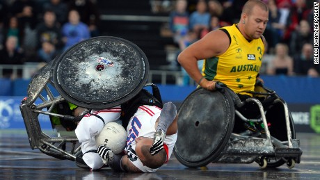 A collision with Batt leaves US player Derrick Helton on the floor during the Wheelchair Rugby Tri-Nations final in Sydney, 2013.