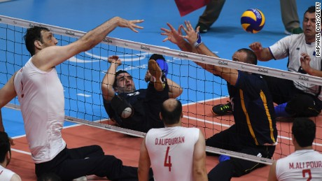 Morteza Mehrzadselakjani (L) of Iran competes during the sitting volleyball gold medal match between Iran and Bosnia and Herzegovina.