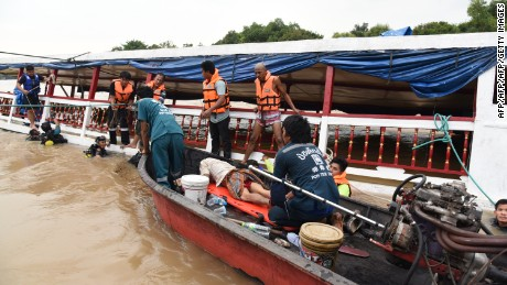 Thai rescuers work to help survivors of a capsized ferry on September 18, 2016.
