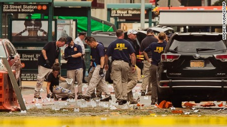 FBI agents at the scene of Saturday's explosion on West 23rd Street and Sixth Avenue in Manhattan's Chelsea neighborhood