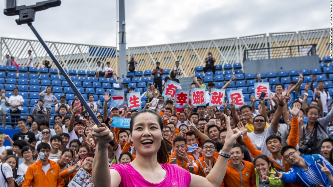 A superstar in China, Li became a global ambassador for her hometown event in May of this year. Here she takes a selfie with fans during a tennis masterclass last year.