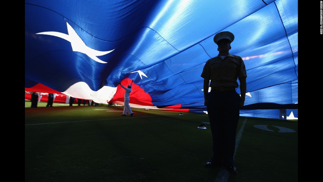 "A U.S. Marine stands at attention under a large American flag before an NFL game in San Diego on Sunday, September 18. <a href=""http://www.cnn.com/2016/09/12/sport/gallery/what-a-shot-sports-0913/index.html"" target=""_blank"">See 34 amazing sports photos from last week</a>"