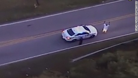 Police helicopter video shows Crutcher walking toward his SUV.