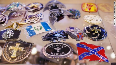 Belt buckles inside a display case at an Albertville gift shop show the city's changing demographics.