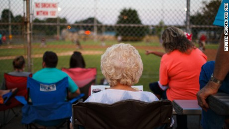 Residents watch a little league game between the Cubs and the Marlins at the Albertville Parks and Recreation Complex.