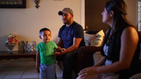 "Freddy and Nancy Salazar relax at home with son Aydan, 2. ""There is no racism between children,"" Freddy Salazar says."
