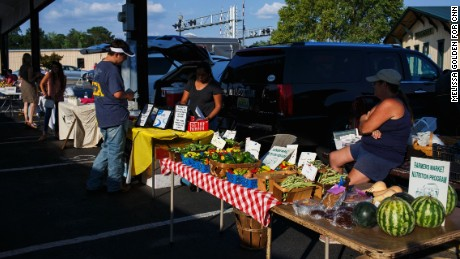Fruits and veggies are plentiful at the Albertville Farmers Market. One vendor says immigrants work hard harvesting crops.