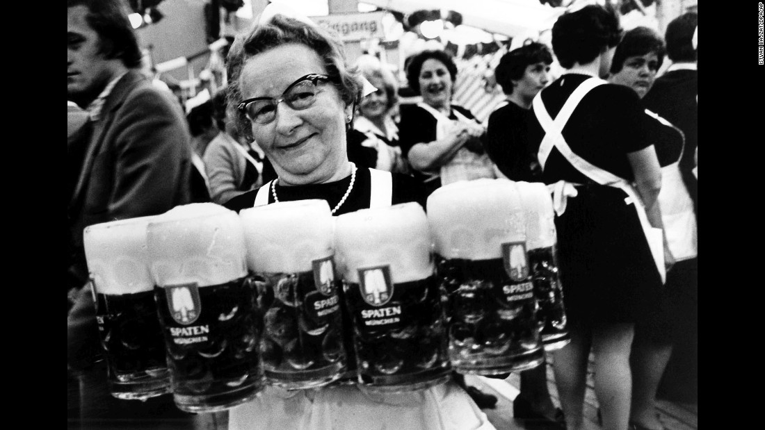 "A waitress carries several glasses of beer in 1979. Munich <a href=""http://www.cnn.com/2010/WORLD/europe/09/21/germany.oktoberfest/"" target=""_blank"">prides itself on its quality of beer,</a> unashamedly calling it the best in the world. It cites Bavarian Purity Requirements that allow only water, hops and barley to be used in the brewing process."