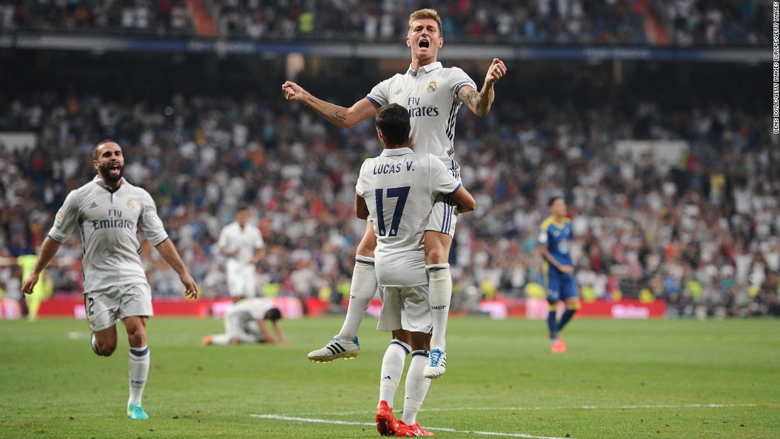 Toni Kroos celebrates with Lucas Vazquez after the German scored the winning goal in Real's win against Celta Vigo August 27.