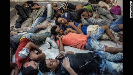 Survivors of a boat that capsized in the Mediterranean on Wednesday sleep in an Egyptian police station.